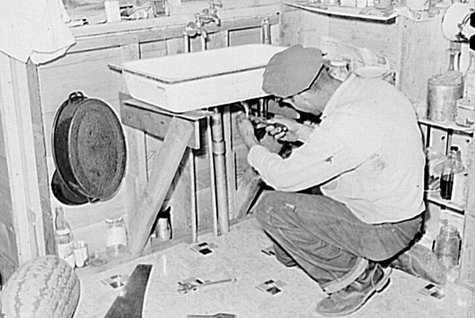 Depot Worker Installs Plumbing