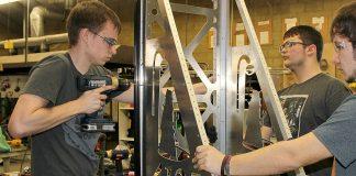 "Caden Sipe drills into ""Carly's"" frame Saturday at Umatilla High School."